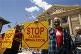 Pictures of Arizona governor signs immigration enforcement bill?